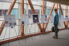 "An attendee reads about undergraduate research projects at the poster presentation for UAA's 14th Annual Undergraduate Research &amp; Discovery Symposium in the spine.  <div class=""ss-paypal-button"">180420-UNDERGRAD RESEARCH SYMPOSIUM-JRE-0050.jpg</div><div class=""ss-paypal-button-end""></div>"