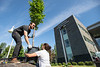 """Zane Miller from UAA Facilities and Maintenance unloads trees with the horticulture team in front of the ConocoPhillips Integrated Science Building in preparation for a belated Arbor Day volunteer tree-planting event to honor UAA's 10 years as a certified Arbor Day Foundation Tree Campus.  <div class=""""ss-paypal-button"""">190614-ARBOR DAY TREE PLANTING-JRE-0096.jpg</div><div class=""""ss-paypal-button-end""""></div>"""