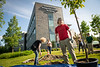 """David Drake helps prapare trees for planting in front of the ConocoPhillips Integrated Science Building during a belated Arbor Day volunteer tree-planting event to honor UAA's 10 years as a certified Arbor Day Foundation Tree Campus.  <div class=""""ss-paypal-button"""">190614-ARBOR DAY TREE PLANTING-JRE-0263.jpg</div><div class=""""ss-paypal-button-end""""></div>"""