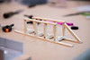 """UAA Summer Engineering Academy students build wood bridges to be tested to failure during the Structure Destruction Academy in UAA's Engineering and Industry Building.  <div class=""""ss-paypal-button"""">190625-SUMMER ENGINEERING ACADEMY-JRE-0485.jpg</div><div class=""""ss-paypal-button-end""""></div>"""