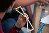 """UAA Summer Engineering Academy students build wood bridges to be tested to failure during the Structure Destruction Academy in UAA's Engineering and Industry Building.  <div class=""""ss-paypal-button"""">190625-SUMMER ENGINEERING ACADEMY-JRE-0611.jpg</div><div class=""""ss-paypal-button-end""""></div>"""