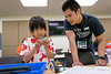 """UAA Engineering student James Flemings helps UAA Summer Engineering Academy students install sensors on their robots during the Lego Robotics Junior Academy in UAA's Engineering and Computation Building.  <div class=""""ss-paypal-button"""">190625-SUMMER ENGINEERING ACADEMY-JRE-0330.jpg</div><div class=""""ss-paypal-button-end""""></div>"""
