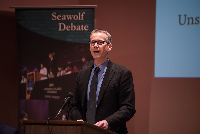 "Seawolf Debate Program Director Steven Johnson moderates an exhibition debate between UAA and Stanford University at Loussac Library's Wilda Marston Theater. UAA's debate team, consisting of John Macy and Robert Hockema, bested Stanford's, arguing the pro on the night's question ""Is America Ready for Socialism?""  <div class=""ss-paypal-button"">190425-DEBATE VS STANFORD-JRE-0038.jpg</div><div class=""ss-paypal-button-end""></div>"