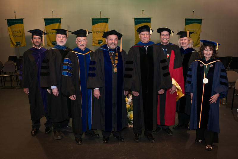 """From left to right: College of Health Dean Jeff Jessee, College of Engineering Dean Fred Barlow, College of Arts and Sciences Dean John Stalvey, Interim Chancellor Sam Gingerich, Interim Provost Duane Hrncir, UA VP of Academic and Student Affairs Paul Layer, College of Education Acting Dean Claudia Dybdahl, and Graduate School Dean Helena Wisniewski prior to the UAA Spring 2018 Graduate Degree Hooding Ceremony.  <div class=""""ss-paypal-button""""><div class=""""ss-paypal-button"""">180505-HOODING-JRE-0007.jpg</div><div class=""""ss-paypal-button-end""""></div></div><div class=""""ss-paypal-button-end""""></div>"""