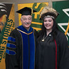 "College of Arts and Sciences Dean John Stalvey with Student Speaker Alexandria McLearen before the UAA 2017 Fall Commencement.  <div class=""ss-paypal-button"">171217-COMMENCEMENT PORTRAITS-JRE-0268.jpg</div><div class=""ss-paypal-button-end""></div>"