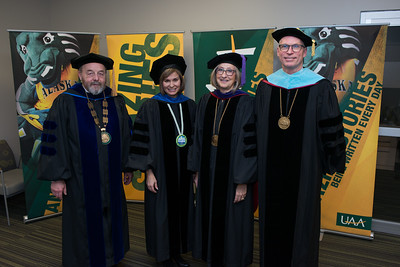 Interim Chancellor Sam Gingerich,  Regents Gloria O'Neill and Mary K. Hughes, and UA President James R. Johnsen before the UAA 2017 Fall Commencement.  171217-COMMENCEMENT PORTRAITS-JRE-0278.jpg