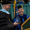 "UA President James R. Johnsen presents the Edith R. Bullock Prize for Excellence to Gunnar Knapp during the UAA 2017 Fall Commencenent.  <div class=""ss-paypal-button"">171217-COMMENCEMENT-JRE-0798.jpg</div><div class=""ss-paypal-button-end""></div>"