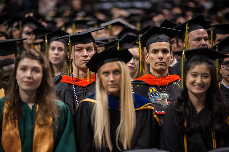 "Andrew White, MS Civil Engineering, right, and Chris Siok, MS Civil Engineering, left, wait to receive their degrees during the UAA Fall 2017 Commencement.  <div class=""ss-paypal-button"">171217-COMMENCEMENT-JRE-0848.jpg</div><div class=""ss-paypal-button-end""></div>"