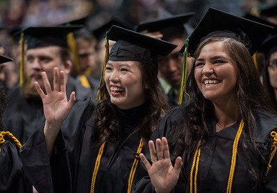 From right: Natasha D. Frable and Isabel G. Sy, both Honors College, BS Medical and Laboratory Science, wave to family during the UAA Fall 2017 Commencement.  171217-COMMENCEMENT-JRE-0381.jpg
