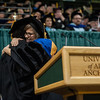 "Diane Kaplan accepts a Meritorious Service Award during the UAA 2017 Fall Commencement.  <div class=""ss-paypal-button"">171217-COMMENCEMENT-JRE-0752.jpg</div><div class=""ss-paypal-button-end""></div>"
