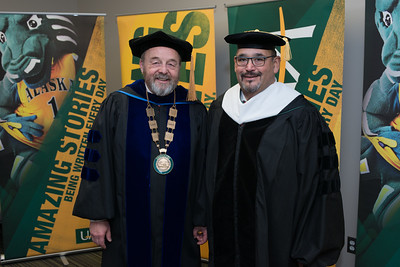 Interim Chancellor Sam Gingerich with Greg Razo, who accepted an Honorary Degree on behalf of Roy Madsen, before the UAA 2017 Fall Commencement.  171217-COMMENCEMENT PORTRAITS-JRE-0259.jpg