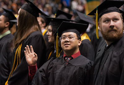 Clynce M. Carrillo, BS Mechanical Engineering, waves to family during UAA's Fall 2017 Commencement.  171217-COMMENCEMENT-JRE-0368.jpg