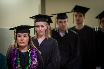 Michelle D. McCoy, Associate of Applied Science, Occupational Safety and Health, waits with others to enter the arena and receive her degree during the UAA 2017 Fall Commencement.  171217-COMMENCEMENT-JRE-0329.jpg