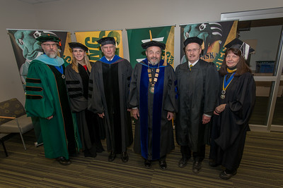 From Left: Bruce Schultz, Vice Chancellor for Student Affairs, Megan Olson, Vice Chancellor for University Advancement, Duane Hrncir, Interim Provost and Executive, Vice Chancellor for Academic Affairs, Samuel Gingerich, Interim Chancellor, Patrick Shier, Interim Vice Chancellor for Administrative Services, Renee Carter-Chapman, Senior Vice Provost for Institutional Effectiveness, before the UAA 2017 Fall Commencement.  171217-COMMENCEMENT PORTRAITS-JRE-0233.jpg