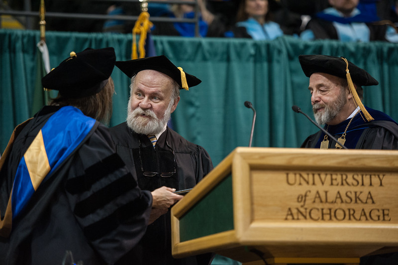 """Rick Goodfellow accepts a Meritorious Service Award during the UAA 2017 Fall Commencement.  <div class=""""ss-paypal-button"""">171217-COMMENCEMENT-JRE-0771.jpg</div><div class=""""ss-paypal-button-end""""></div>"""