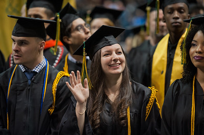 Jolaine A. Polak, Honors College, BS Biological Sciences, waves to family during the UAA Fall 2017 Commencement.  171217-COMMENCEMENT-JRE-0385.jpg