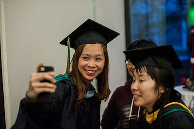 Education Masters recipient Huiyu Lin, left, and Interdisciplinary Studies Masters Recipient Megumi Aisu, right, take a selfie with a friend at UAA's Fall 2017 Graduate Degree Hooding Ceremony.  171216-HOODING-JRE-0911.jpg