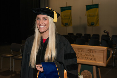 "Rachel Wahto at UAA's Fall 2017 Graduate Degree Hooding Ceremony. Wahto earned her Ph. D. in Clinical-Community Psychology with a Rural Indiginous Emphasis. Her dissertation title is: ""Predictors of Therapists' Attitudes, Outcome Expectations, and Preferences for Therapy.""  171216-HOODING-JRE-0014.jpg"
