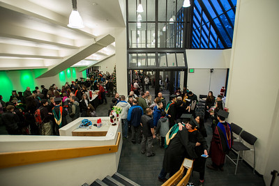 Friends and family mingle with graduate degree recipients in the lobby of the Wendy Williamson Auditorium after UAA's Fall 2017 Graduate Degree Hooding Ceremony.  171216-HOODING-JRE-0884.jpg