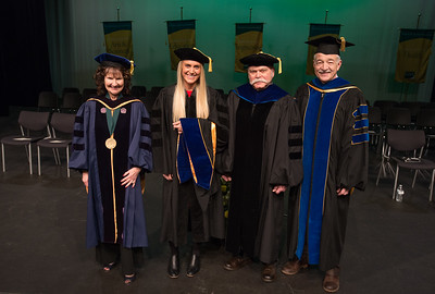 "Rachel Wahto with Graduate School Dean Dr. Helena Wisniewski, left, Dr. JJames Fitterling, right, and CAS Dean Dr. John Stalvey, far right, at UAA's Fall 2017 Graduate Degree Hooding Ceremony. Wahto earned her Ph. D. in Clinical-Community Psychology with a Rural Indiginous Emphasis. Her dissertation title is: ""Predictors of Therapists' Attitudes, Outcome Expectations, and Preferences for Therapy.""  171216-HOODING-JRE-0030.jpg"