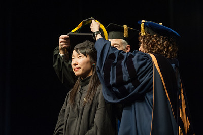 Interdisciplinary Studies Masters Recipient Megumi Aisu is hooded at UAA's Fall 2017 Graduate Degree Hooding Ceremony.  171216-HOODING-JRE-0302.jpg