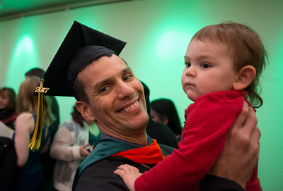 Andrew White, MS Civil Engineering, celebrates with family after being hooded at UAA's Fall 2017 Graduate Degree Hooding Ceremony.  171216-HOODING-JRE-0854.jpg