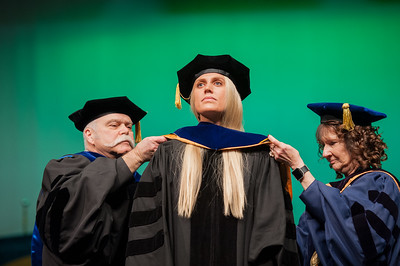 "Rachel Wahto is hooded by Dr. James Fitterling and Graduate School Dean Helena Wisniewski at UAA's Fall 2017 Graduate Degree Hooding Ceremony. Wahto earned her Ph. D. in Clinical-Community Psychology with a Rural Indiginous Emphasis. Her dissertation title is: ""Predictors of Therapists' Attitudes, Outcome Expectations, and Preferences for Therapy.""  171216-HOODING-JRE-0233.jpg"