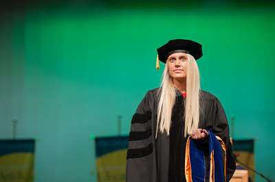 "Rachel Wahto waits to be hooded at UAA's Fall 2017 Graduate Degree Hooding Ceremony. Wahto earned her Ph. D. in Clinical-Community Psychology with a Rural Indiginous Emphasis. Her dissertation title is: ""Predictors of Therapists' Attitudes, Outcome Expectations, and Preferences for Therapy.""  171216-HOODING-JRE-0221.jpg"