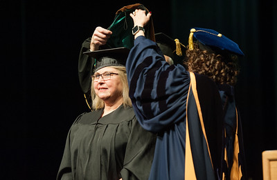 Amy E. Holonics, Master of Fine Arts, Creative Writing and Literary Arts, is hooded at UAA's Fall 2017 Graduate Degree Hooding Ceremony.  171216-HOODING-JRE-0299.jpg