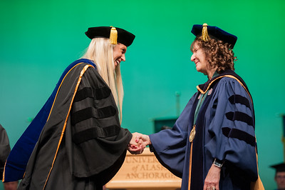"Rachel Wahto is hooded by Dr. Joshua Smith and Graduate School Dean Helena Wisniewski at UAA's Fall 2017 Graduate Degree Hooding Ceremony. Wahto earned her Ph. D. in Clinical-Community Psychology with a Rural Indiginous Emphasis. Her dissertation title is: ""Predictors of Therapists' Attitudes, Outcome Expectations, and Preferences for Therapy.""  171216-HOODING-JRE-0259.jpg"