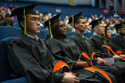 Kaixin Lu, MS, Project Management, and other graduate degree recipients wait to be hooded at UAA's Fall 2017 Graduate Degree Hooding Ceremony.  171216-HOODING-JRE-0153.jpg