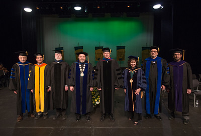 From left: CAS Dean John Stalvey, College of Business and Public Policy Dean Bogdan Hoanca, College of Engineering Dean Fred Barlow, UAA Interim Chancellor Sam Gingerich, UAA Interim Provost Duane Hrncir, Graduate School Dean Helena Wisniewski, College of Education Dean Paul Deputy, and College of Health Dean Jeff Jessee, at UAA's Fall 2017 Graduate Degree Hooding Ceremony.  171216-HOODING-JRE-0046.jpg