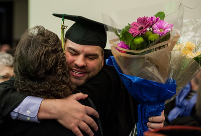 MBA recipient Ryan F. Dieckgraeffat celebrates with family after UAA's Fall 2017 Graduate Degree Hooding Ceremony.  171216-HOODING-JRE-0859.jpg