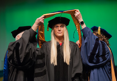 "Rachel Wahto is hooded by Dr. James Fitterling and Graduate School Dean Helena Wisniewski at UAA's Fall 2017 Graduate Degree Hooding Ceremony. Wahto earned her Ph. D. in Clinical-Community Psychology with a Rural Indiginous Emphasis. Her dissertation title is: ""Predictors of Therapists' Attitudes, Outcome Expectations, and Preferences for Therapy.""  171216-HOODING-JRE-0227.jpg"
