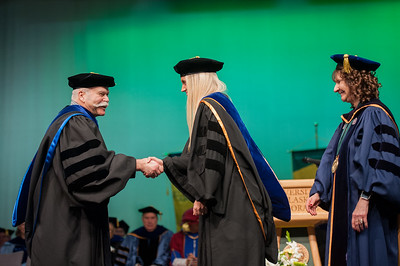 "Rachel Wahto is hooded by Dr. James Fitterling and Graduate School Dean Helena Wisniewski at UAA's Fall 2017 Graduate Degree Hooding Ceremony. Wahto earned her Ph. D. in Clinical-Community Psychology with a Rural Indiginous Emphasis. Her dissertation title is: ""Predictors of Therapists' Attitudes, Outcome Expectations, and Preferences for Therapy.""  171216-HOODING-JRE-0256.jpg"