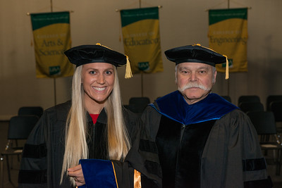 "Rachel Wahto with Dr. James Fitterling at UAA's Fall 2017 Graduate Degree Hooding Ceremony. Wahto earned her Ph. D. in Clinical-Community Psychology with a Rural Indiginous Emphasis. Her dissertation title is: ""Predictors of Therapists' Attitudes, Outcome Expectations, and Preferences for Therapy.""  171216-HOODING-JRE-0015.jpg"