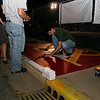 Fraternity members decided to paint a block of cement along the football field for Homecoming.