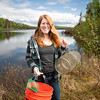 UAA Biology Graduate Student Kelly Ireland with collecting equipment at South Rolly Lake as researchers from UAA, University of Massachusetts Lowell, University of Connecticut, and University of Texas at Austin collaborate on a joint field collection of stickleback fish. The tiny and abundant fish are the subject of intensive study at UAA and elsewhere because of their genetic variability and their surprising physiological parallels with humans.<br /> <br /> 190528-KELLY IRELAND STICKLEBACKS-JRE-0866