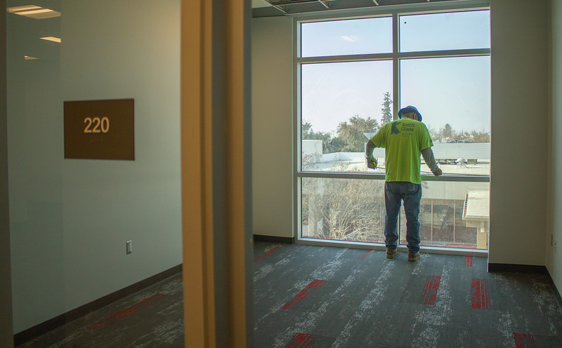 A construction worker puts the finishing touches on the executive rooms on the second floor of the Campus Center.