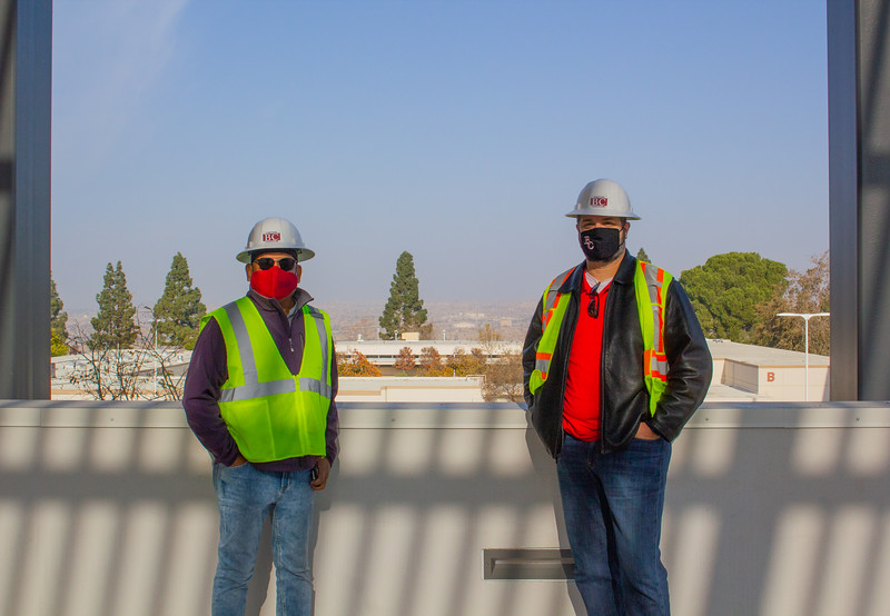 Food Services Director Fidel Cabuena and Vice President of Finance and Administrative Services Mike Giacomini pose on the third floor of the new Campus Center.