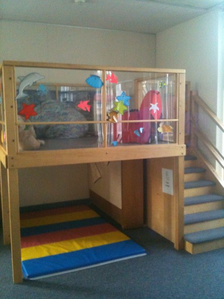 A crawlspace beneath the area where toys are stored is a perfect place for the children to relax.