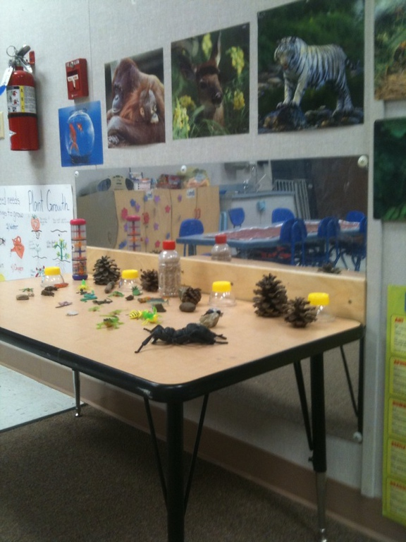 students display their school projects on a table in one of the CDC's classrooms.