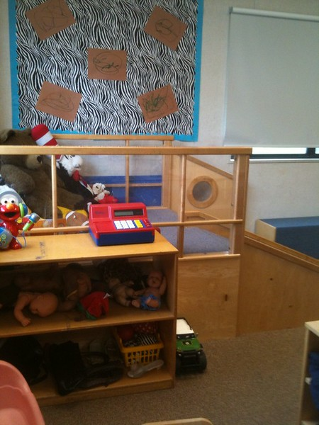 Students' toys are put up in a corner of one of the CDC's classrooms