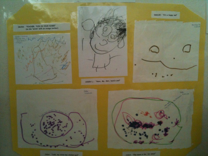 Students display some of their drawings up on the wall inside the Child Development Center.