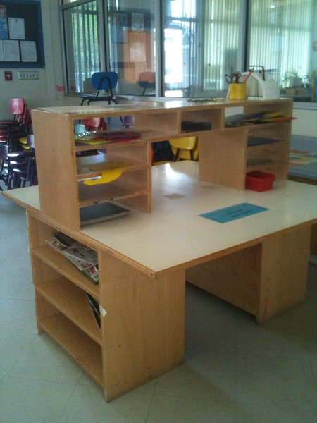 Some students keep their work inside of cubby holes located in the classrooms.