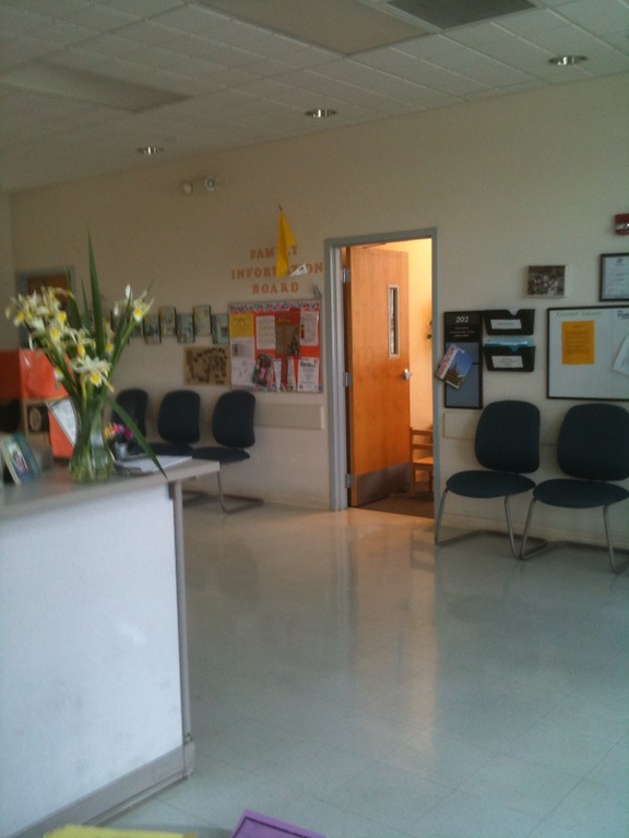 The front desk of the Child Development Center is to the left, and our Family Information Board is across from it.