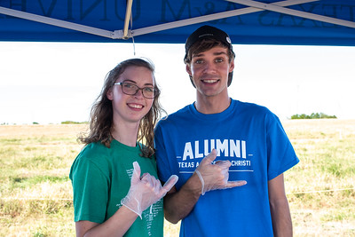 Sydney Patillo (let) and Jared Ulch help serve root-beer floats for the guests attedning the Islander Soccer Tailgate outside Dugan Stadium