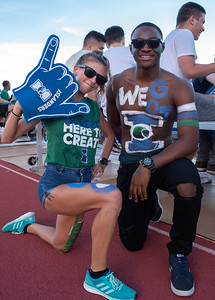 Allyson Girard (left) and Clancy Tse show islander spirit during Islanders vs. Texas State soccer game at Dugan Statdium