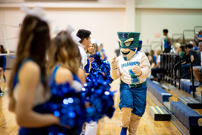 Izzy the Islander helps energize the crowd along with the Islanders Cheer and Dance team during the Islanders vs UTRGV volleyball game.
