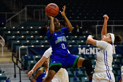 Texas A&M-Corpus Christi's Dae Dae Evans shoots a jump shot in the first quarter. On March, 10, 2017 at the Leonard E. Merrell Center in Katy T.X
